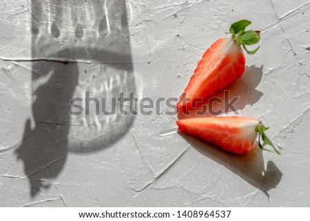 Long shadows and reflections from transparent pieces of crushed ice cubes in the round form on a blu Stock photo © artjazz