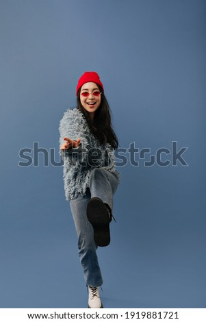 full length photo of happy asian woman with long dark hair looki stock photo © deandrobot