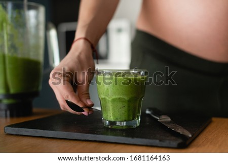 Female hand takes the spoon with organic yogurt smoothie , strawberries, blueberry, oat flakes, nuts Stock photo © artjazz