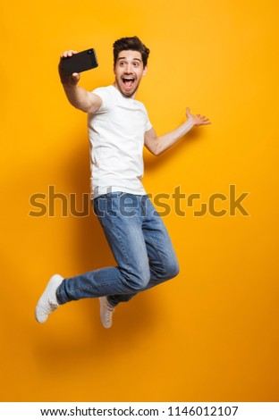 Happy brunette man 30s with stubble in white shirt taking selfie Stock photo © deandrobot