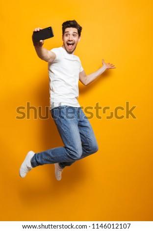 Boldog barna hajú férfi 30-as évek borosta fehér Stock fotó © deandrobot