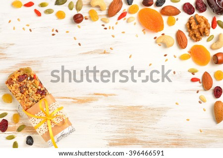 Homemade organic granola cereal bars with nuts and dried fruit on white background Stock photo © DenisMArt