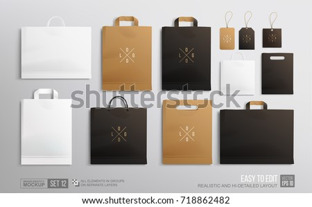 Realistic Paper shopping bag with handles set isolated on white background. Vector illustration Stock photo © olehsvetiukha