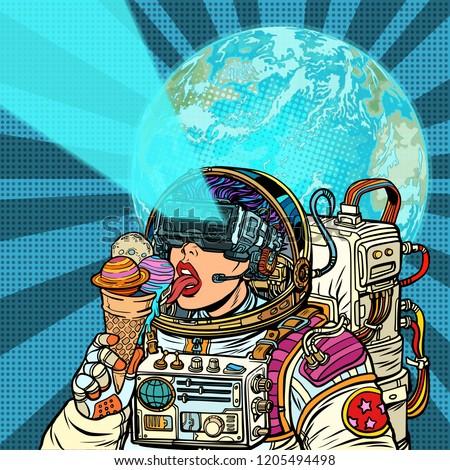 woman astronaut eats planets of the solar system like ice cream stock photo © studiostoks