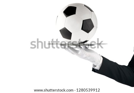 Waiter that holds a tray with soccer ball. Concept of first class service on soccer Stock photo © alphaspirit