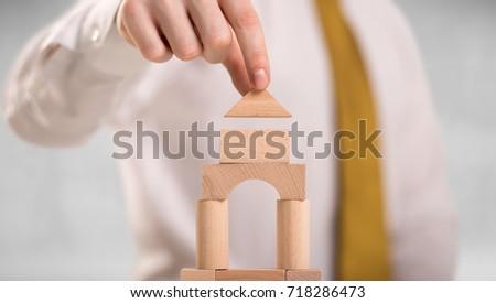 Businessman building a tower Stock photo © ra2studio
