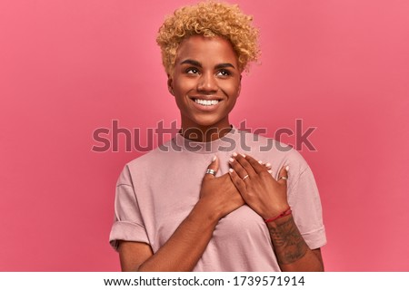 Photo of adorable african american woman keeping palms together  Stock photo © deandrobot