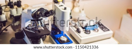 A sample preparation table in a laboratory with an optical microscope, ultrasonic cutter system and  Stock photo © galitskaya