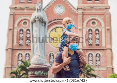 Father and son in the background Notre dame de Saigon Cathedral, build in 1883 in Ho Chi Minh city,  Stock photo © galitskaya