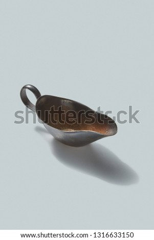 Vintage retro steel empty gravy boat on a white background with shadows, place for text. Stock photo © artjazz