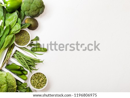 assorted green toned raw organic vegetables on white background avocado cabbage broccoli caulifl stock photo © denismart