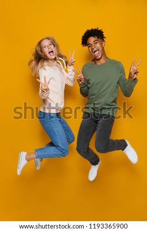 写真 · 興奮した · アフリカ系アメリカ人 · カップル · 立って · 一緒に - ストックフォト © deandrobot