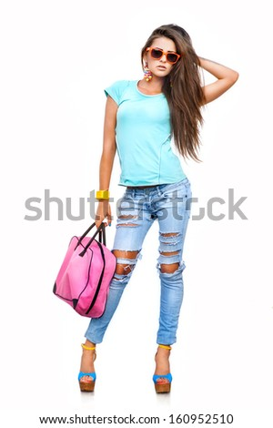 Full length portrait of young brunette girl in sunglasses jumping and holding her hair in hands. Smi stock photo © studiolucky