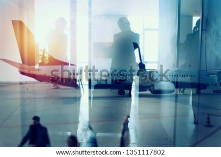 Silhouettes of businessman at the airport who waits for boarding. Double exposure Stock photo © alphaspirit