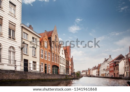view canal and colorful traditional houses against cloudy blue s stock photo © artjazz