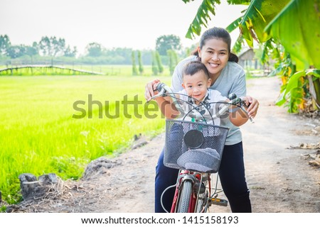 mom and son on the rice field in the background of rice terraces ubud bali indonesia traveling w stock photo © galitskaya