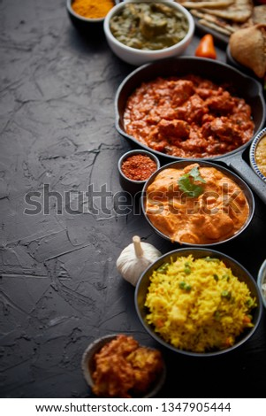 Composition of Indian cuisine in ceramic bowls on black stone table Stock photo © dash