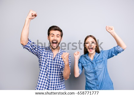 Stock photo: Emotional young couple friends students standing isolated over white wall background showing thumbs