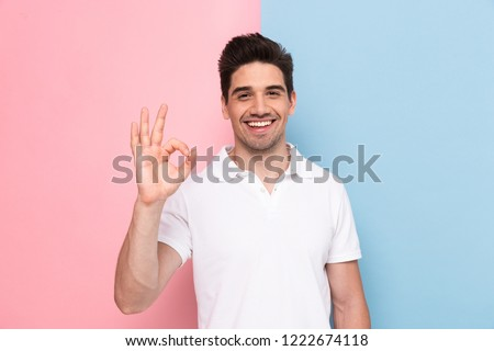 Image of man 30s having stubble showing ok sign with happy smile Stock photo © deandrobot