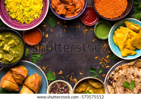 Assorted indian food on dark wooden background. Dishes and appetizers of indian cuisine. Curry, butt Stockfoto © galitskaya