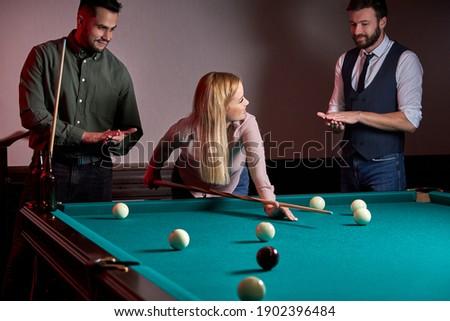 Woman receiving advice on shooting pool ball while playing billiards Stock fotó © Kzenon