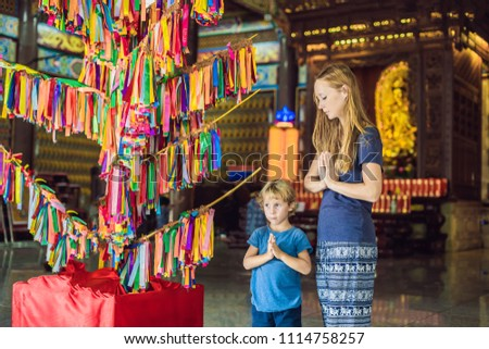 Mother and son tourists in Buddhist temple Kek Lok Si in Penang, Malaysia, Georgetown. Traveling wit stock photo © galitskaya