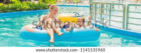 beautiful young man having fun at an amusement park banner long format stock photo © galitskaya