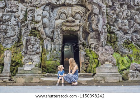 mom and son are tourists in old hindu temple of goa gajah near ubud on the island of bali indonesia stock photo © galitskaya