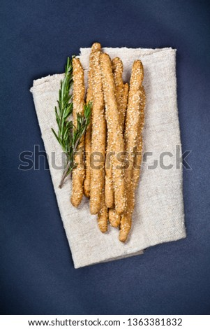 Italian grissini or salted bread sticks with rosemary herb on li Stock photo © marylooo