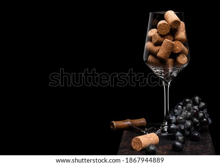Bottles of red wine with dark grapes inside vintage wooden box on black stone background. Elegant wi Stock photo © DenisMArt
