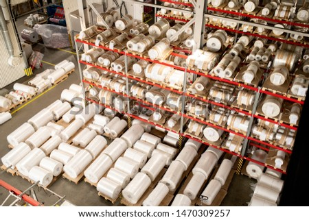 Many rolled polyethylene film units on shelves and racks inside warehouse Stock photo © pressmaster