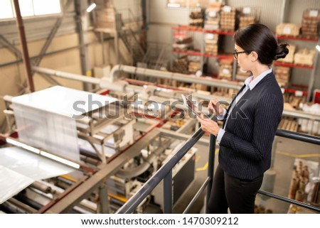 Young quality control expert with touchpad testing new industrial equipment Stock photo © pressmaster