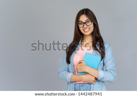 Young successful teacher of literature or college student with stack of books Stock photo © pressmaster