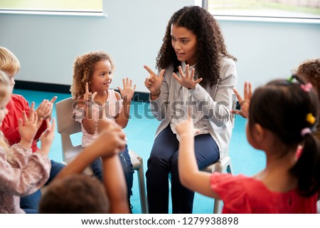 Front view of female teacher teaching the kids about the globe at table in school library Stock photo © wavebreak_media