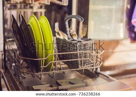 Dishwasher with dirty dishes. Powder, dishwashing tablet and rinse aid. Washing dishes in the kitche Stock photo © galitskaya
