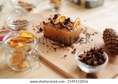 Large soap bar with cinnamon sticks, star anise and orange slices on board Stock photo © pressmaster