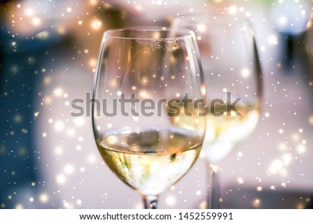 Winter holiday glasses of white wine and glowing snow on backgro Stock photo © Anneleven