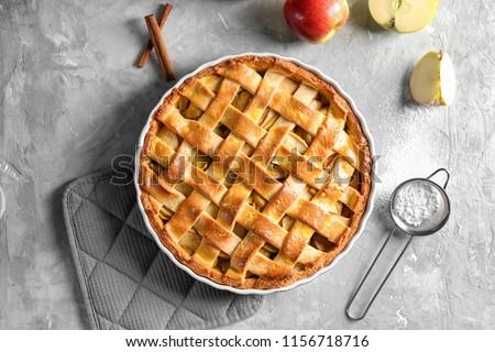 Tasty sweet homemade apple pie cake with cinnamon sticks, walnuts and apples Stock photo © dash