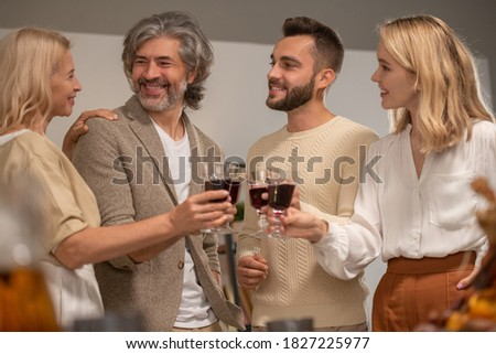 Happy mature and young family members clinking with wine during Christmas toast Stock photo © pressmaster