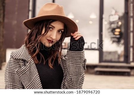 Outside shot of charming young woman with long hair, wears polka dot green shirt, sits at table in o Stock photo © vkstudio
