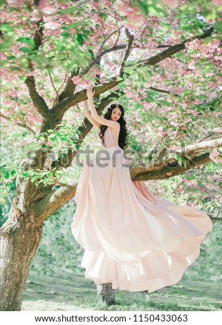 A beautiful woman in a white long dress like a bride in a public Park Stock photo © ElenaBatkova