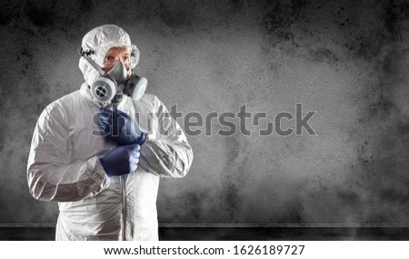Man Wearing Hazmat Suit, Protective Gas Mask and Goggles Against Stock photo © feverpitch