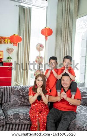 Mom and son celebrate Chinese New Year look at Chinese red lanterns. Chinese lanterns are reflected  Stock photo © galitskaya