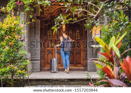 Young beautiful woman check in authentic hotel in Bali. Tourism Bali Concept BANNER, LONG FORMAT Stock photo © galitskaya