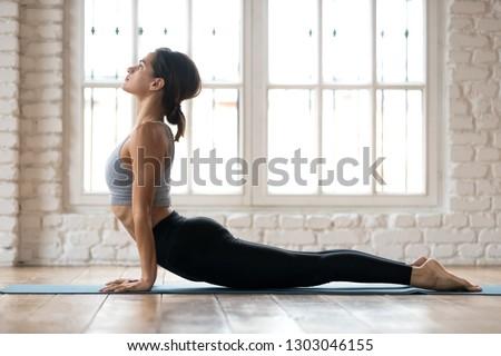 Woman practices yoga asana Urdhva Mukha Svanasana at the beach Stock photo © dmitry_rukhlenko