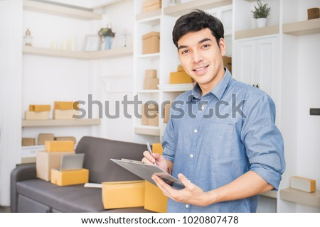 Asian business man startup SME entrepreneur or freelance working Stock photo © snowing