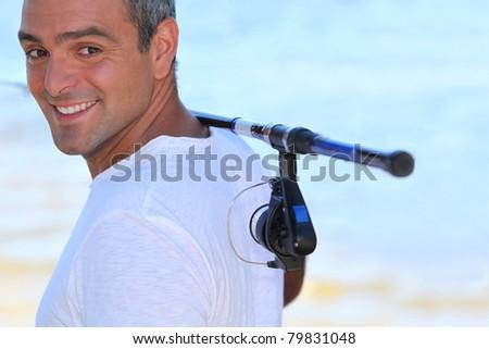 40 années vieillard marche plage canne à pêche épaule Photo stock © photography33