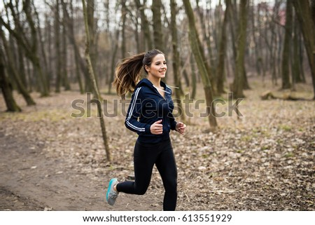 Young woman running outdoors on a lovely sunny winter/fall day  stock photo © lightpoet