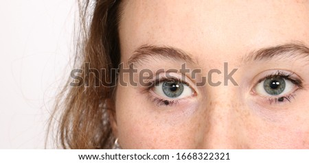 Closeup of a fair haired young woman wearing makeup but no clothes. Stock photo © photography33