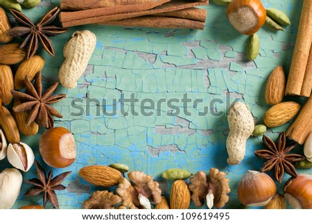 Aroma spices frame. Cinnamon, anise, peanuts, almonds, cardamom, hazelnuts on the vintage wooden sur Stock photo © yelenayemchuk